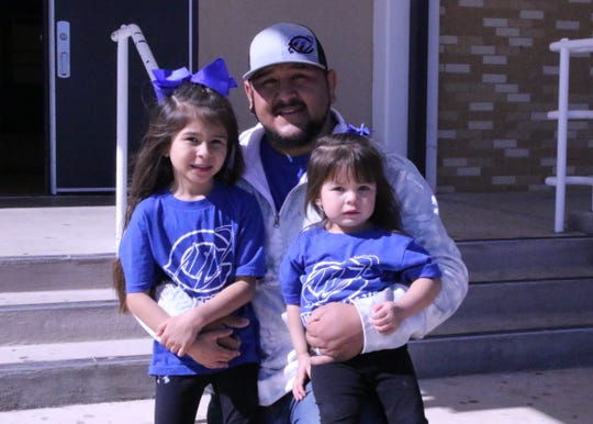 Carlsbad wrestling coach Ryan Salcido poses with his two daughters RyAna, left, and JoAna, right, before heading to the 2019 NM State Wrestling Tournament in February. Salcido will be stepping down as head wrestling coach to spend more time with his family after six years coaching the Cavemen.