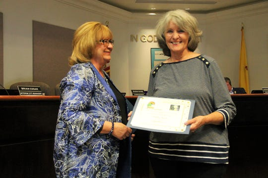 Alamogordo City Commissioner Nadia Sikes presents the first certificates for attractive yards in the city to Shelley Wade of 16th Street (pictured) and Ben Thuesen of San Andres  at the regular Alamogordo City Commission meeting May 28.