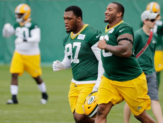 Green Bay Packers defensive end Mike Daniels (76) and nose tackle Kenny Clark (97) warmup during practice at Clarke Hinkle Field on Wednesday, May 29, 2019 in Ashwaubenon, Wis.