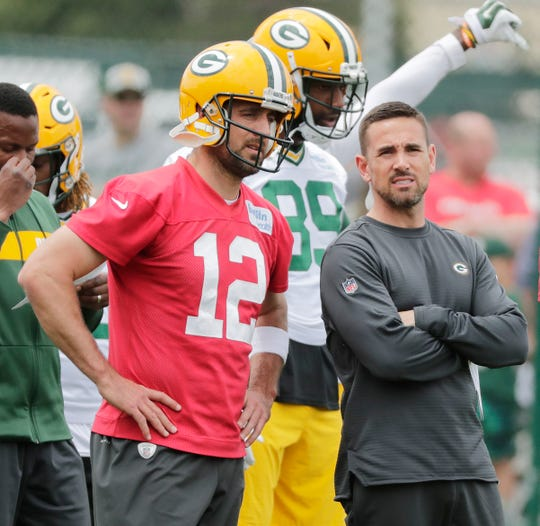 Green Bay Packers head coach Matt LaFleur and quarterback Aaron Rodgers (12) during practice at Clarke Hinkle Field on Wednesday, May 29, 2019 in Ashwaubenon, Wis.