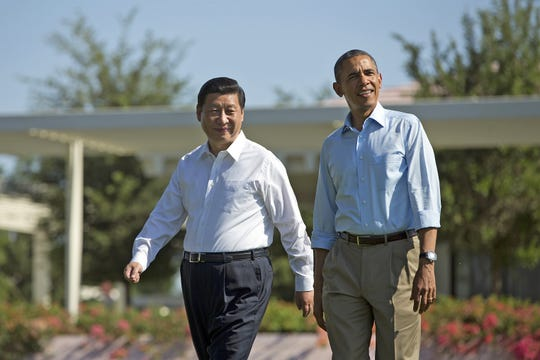 "President Barack Obama and Chinese President Xi Jinping, left, walk at the Annenberg Retreat of the Sunnylands estate Saturday, June 8, 2013, in Rancho Mirage, Calif. Obama told reporters his meetings with Xi have been ""terrific."""