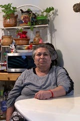 Rosalinda Lopez sits at her kitchen table in her East Side Los Angeles apartment where she lives with her disabled granddaughter. She already has a list of the food items she is going to buy on June 1, the day that she and hundreds of thousands of other elderly and disabled Californians will be eligible to go grocery shopping with their new CalFresh benefits. (Courtesy of Marisol Mota)