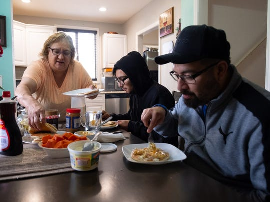 Leticia  makes breakfast for her sons, Angel and J.C. Martinez