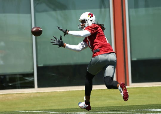 Cardinals receiver Larry Fitzgerald catches a pass during an OTA practice on May 29.
