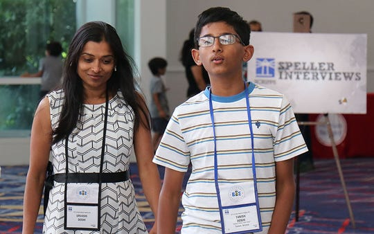 "Tanish Doshi, an Oro Valley eighth-grader, at the bee with his mom, Urvashi. He said he easily makes friends with other spellers at the bee, because the real rival ""is the dictionary."""