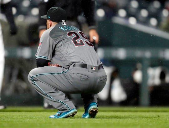 Arizona Diamondbacks starting pitcher Merrill Kelly reacts after giving up a two-run home run to Colorado Rockies' Chris Iannetta in the seventh inning of a baseball game, Tuesday, May 28, 2019, in Denver. Colorado won 6-2. (AP Photo/David Zalubowski)