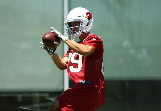 Cardinals rookie receiver Andy Isabella catches a pass during an OTA practice on May 29.