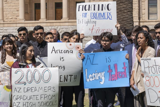 "Blanca Sierra-Reyes, a DACA recipient from Hidalgo, Mexico, speaks to media while ""Dreamers"" and student supporters rally at the Arizona state Capitol. Protesters were asking legislators to support ""Dreamers"" so they can be eligible for in-state tuition and merit-based scholarships."