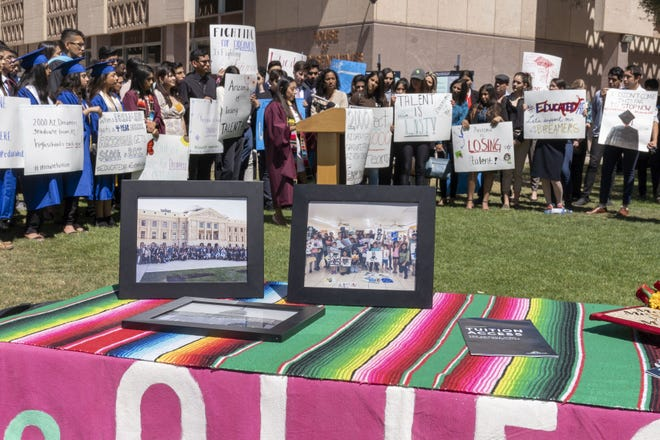 """Blanca Sierra-Reyes, a DACA recipient from Hidalgo, Mexico, speaks to media while """"dreamers"""" and student supporters rally at the Arizona state Capitol."""
