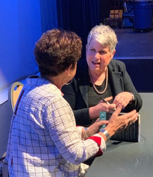 Former Homeland Security Secretary Janet Napolitano signs copies of her book in Phoenix on Tuesday.