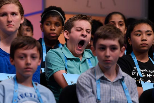 Sebastian Shields, 12, of Saco, Maine, yawns as he waits his turn to compete in the second round of the Scripps National Spelling Bee in Oxon Hill, Md., Tuesday, May 28, 2019. (AP Photo/Susan Walsh)
