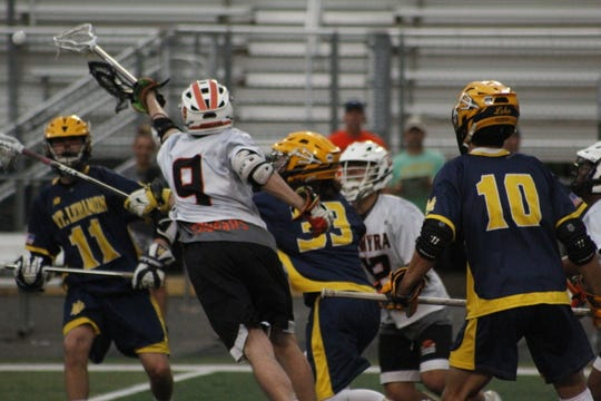 Palmyra and Mt. Lebanon players battle for possession during action in Tuesday night's game.