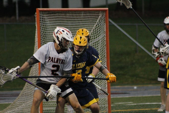 Palmyra's Grant Haus battles against a Mt. Lebanon defender during Tuesday's opening round state playoff game. Palmyra fell 10-9 when play was halted with 9:02 left due to weather.
