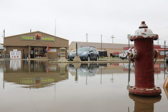 Winds coming out of the northeast once again brought Lake Erie's record-high waters up to the doorstep of local businesses on Madison Street in downtown Port Clinton on Wednesday.