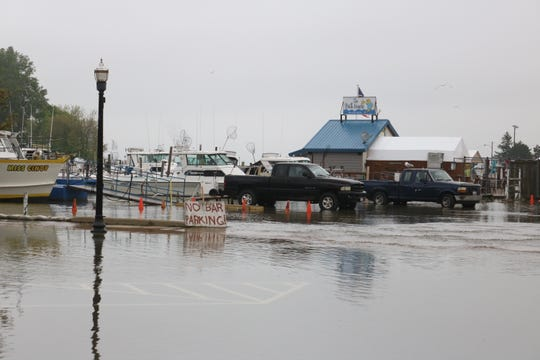 Winds coming out of the northeast once again brought Lake Erie's record-high waters over the end of Madison Street in downtown Port Clinton on Wednesday.