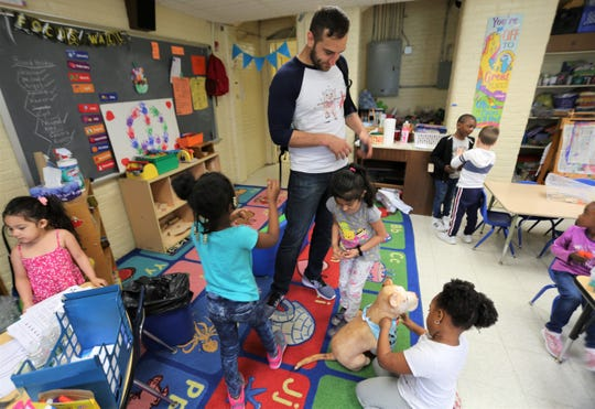 Jason Kraus hangs out with his mother's students at Early Learning Center in the City of Poughkeepsie on Wednesday, May 29, 2019. Kraus published a book Belly Rubbins For Bubbins three weeks ago. He was at the school to read to multiple classes.