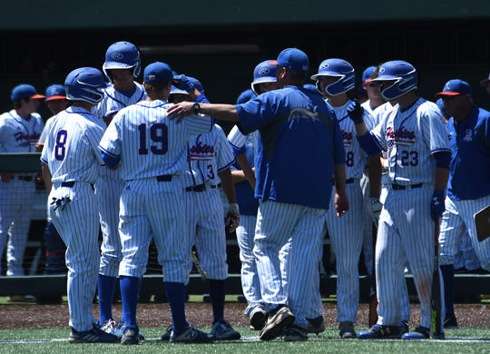 Reno head coach Pete Savage talks with his players while taking on Bishop Manogue during their Northern region championship game at Peccole Park in Reno on May 11, 2019.