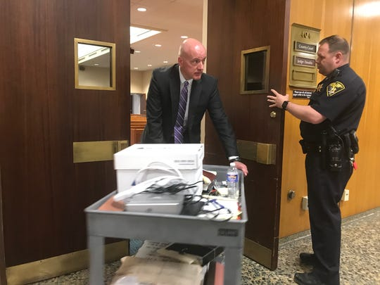 Assistant District Attorney Christopher Bokelman wheels out the evidence and exhibits he presented to the jury during closing arguments in the double-homicide trial of Samuel Shaw Wednesday in Monroe County Court.