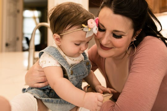 Ashley Presciutti, 36, of Hilton and her one-year-old daughter Eliza.