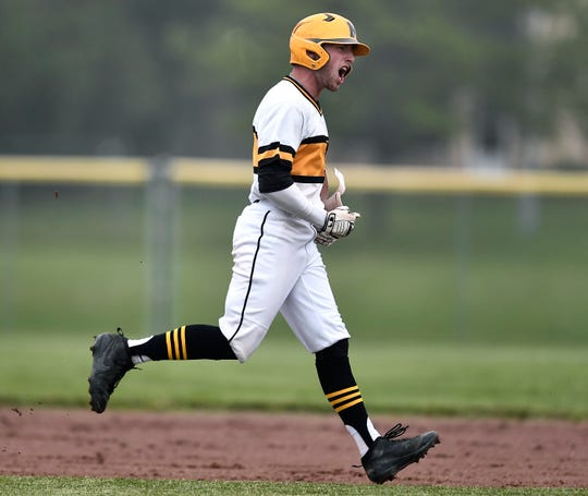 McQuaid's Ben Beauchamp celebrates a double during a Class AA sectional quarterfinal against Fairport at McQuaid Jesuit High School, Tuesday, May 28, 2019. No. 1 seed McQuaid advanced to the Class AA semifinal with a 1-0 win over No. 9 seed Fairport.