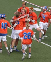 Penn Yan players celebrate following their win in sudden-death overtime 10-9 over Pal-Mac in their Section V Class D Championship game.