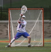 Fairport goalie Tim Defends makes this stop against Hilton.