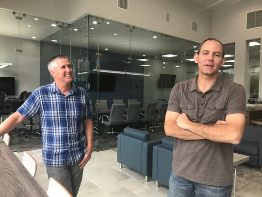 Dropin founders Brad Rostocil, right, and Greg Ramsey talk about their new business, which offers working spaces with a secure, fiber internet connection.