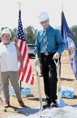 Maurice Johannessen, right, stands with shovels next to Candi Tucker, administrative officer at the Redding VA Outpatient Clinic, during the groundbreaking ceremony, Wednesday, May 29, 2019, for a new veterans clinic on Knighton Road.