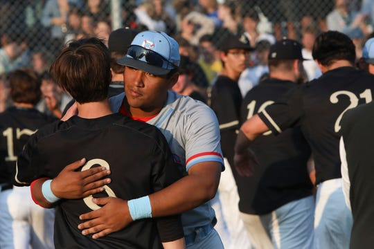 South Salem's Danny Alvarado hugs Jesuit's Campbell Brandt following South Salem's 3-2 loss to Jesuit during an OSAA 6A semifinal game in Beaverton, Ore. on Tuesday, May 28.