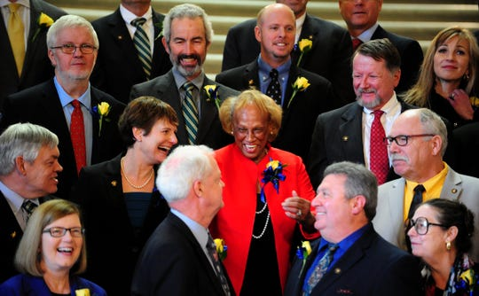 Jackie Winters, R-Salem, is the center of attention while getting ready for a group picture of Senators during the first day of the 2015 Oregon Legislature at the Oregon State Capitol in Salem on Jan. 12, 2015.