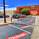 Chick-fil-A in Sunset Mall, 4001 Sunset Drive, designates seven parking spots for its Curbside Drive-Up service.
