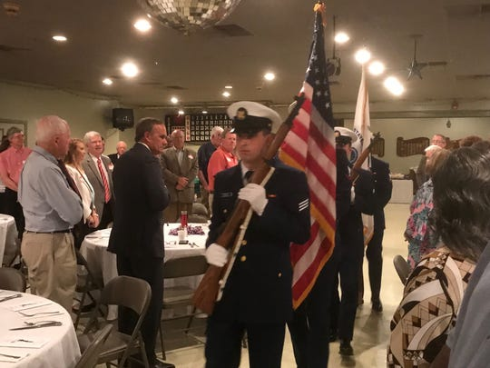 A U. S. Coast Guard, Chincoteague color guard enters the room at the start of the Eastern Shore Christian Businessmen's Association 2019 Prayer Breakfast on Wednesday, May 29, 2019 in Accomac, Virginia.
