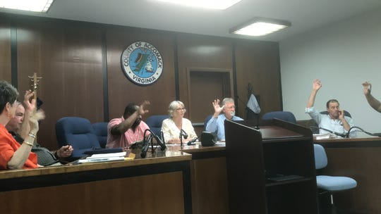 Accomack County School Board Selection Commission members raise their hand to vote for an appointment during their final meeting on Wednesday, May 29, 2019 in Accomac, Virginia. Accomack County voters approved a change to an elected school board as of 2020. Candidates will be vying for the nine school board seats in the November 2019 election.