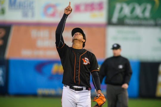 Delmarva Shorebirds' pitcher Ofelky Peralta points to the sky at Arthur W. Perdue Stadium.