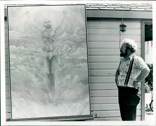 Carl Grupp admires a painting.