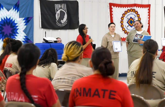 Heather Shooter of the Cheyenne River tribe, Tasha Qualley of the Sisseton Wahpeton Oyate tribe and Dawn Frazier of  the Cheyenne River tribe welcome a crowd of 90 fellow inmates and invited guests to an anti-meth rally put on by their nonprofit, Sober is Sacred, at the South Dakota Women's Prison on Tuesday, May 24, in Pierre. Shooter founded Sober is Sacred while incarcerated and the organization recently earned official nonprofit status.