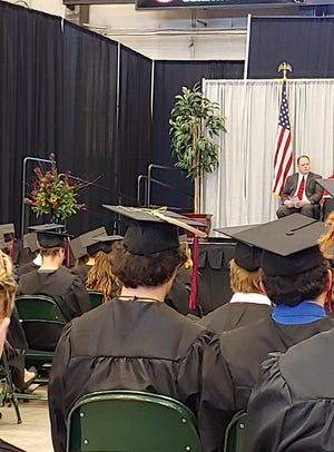 Miles Livermont at Brookings High School graduation with an eagle feather attached to his graduation cap on May 26, 2019.