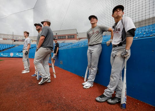 Grant Harris, right, and other members of the Willard baseball team wait to take batting practice at US Baseball Park in Ozark in 2019.