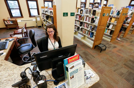 "Aleah Weltha, the reference department manager at the Midtown Carnegie Branch Library, checks her email while working on Wednesday, May 29, 2019. Weltha is one of the librarians that respond to users of the the library's new online tool ""Your Next Read"" with recommendations."