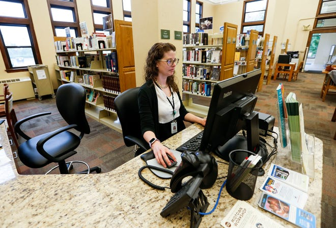 """Aleah Weltha, the reference department manager at the Midtown Carnegie Branch Library, checks her email while working on Wednesday, May 29, 2019. Weltha is one of the librarians that respond to users of the the library's new online tool """"Your Next Read"""" with recommendations."""