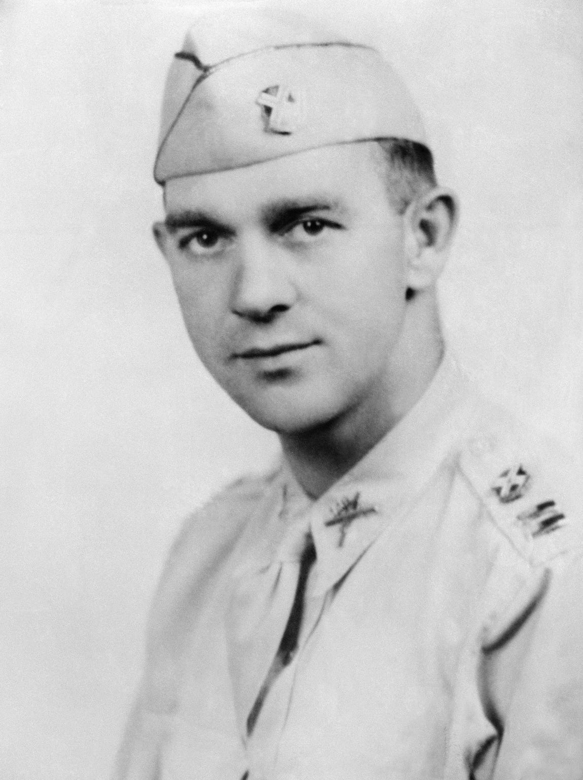 """Thomas D. Howie, of Stauton, Va., serving with the 116th Infantry, has been identified as the heroic """"Major of St. Lo"""" who was killed in action, July 17, while leading his troops into the Normandy City, and whose flag-draped body was placed on a pile of rubble by a church as his men continued to fight on before it. (AP Photo)"""