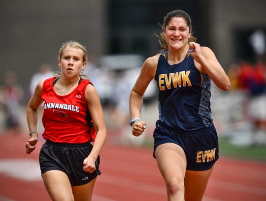 McKenna Moehrle of Eden Valley-Watkins/Kimball and Mackenzie Matthees of Annandale compete in the 100 meter dash prelims during the Section 5A Track and Field Championships Wednesday, May 29, at St. John's University in Collegeville.