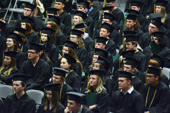 The Sauk Rapids-Rice Class of 2019 listens to speakers and music during commencement Tuesday night at St. Cloud State's Halenbeck Hall.