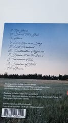 A photo shows the song list for Lisa Landucci's first solo album.
