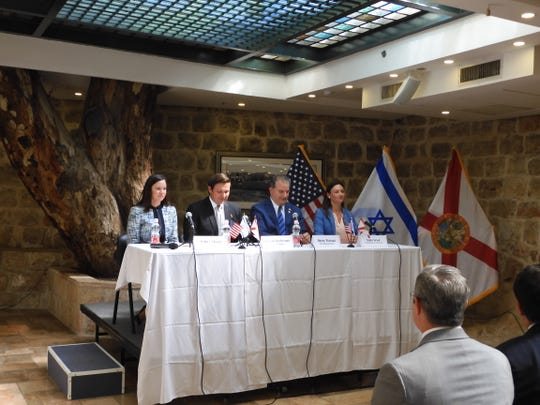 Cabinet members and Gov. DeSantis at the makeshift dais in the Wasson Room of the US Embassy annex in Jerusalem