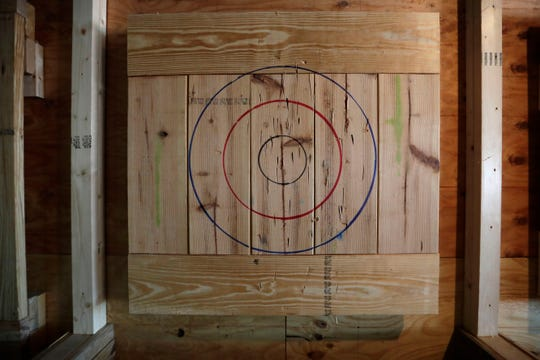 A wooden target hangs on the wall at Tomahawks 51 Axe Throwing, a place where people can have fun by throwing axes at a target, which is in the works to open at the end of June 2019.