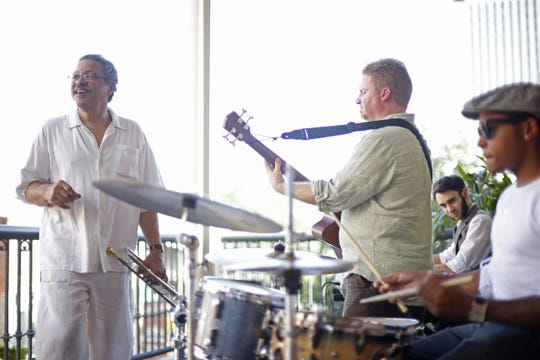 The Longineu Parsons ensemble plays on the Governor's Club balcony as a part of Tallahassee Music Week in 2015.