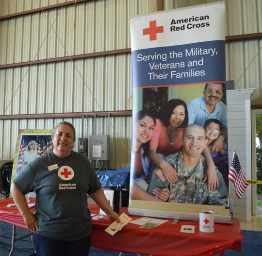 Heidi O'Sheehan, regional director of Service to the Armed Forces, hands out information on how the Red Cross serves military members, veterans and their families.