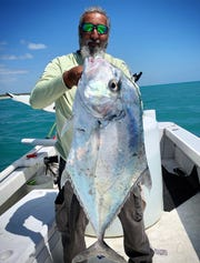 Adam Argona of Port St. Lucie caught this whopper of an African pompano in 30 feet of water off Jupiter Island while fishing with Capt. James Cronk of 772 Fly and Light Tackle charters in Stuart. He used a live pilchard.