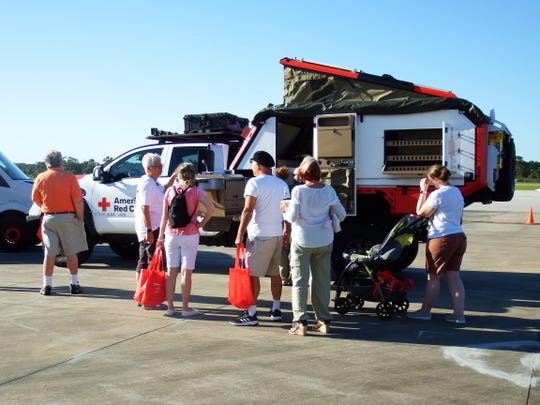 Guests to the 2019 Hangar Party at the Vero Beach Regional Airport check out the new American Red Cross Titan vehicle, donated by Nissan, that is deployed to major disasters. The May 17 event was sponsored by Florida's Coast to Heartland Chapter of the American Red Cross.